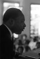 Martin Luther King, Jr., speaking to an audience in a church building, probably First Baptist Church in Eutaw, Alabama.