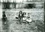 Four sitting children