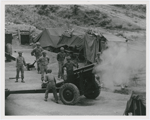 Vietnamese artillerymen fire from a mountain position during field training