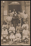 [African American baseball team posing on front steps of building]