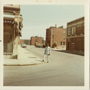 Reverend Michael E. Haynes stands on the corner of an empty street in Lower Roxbury.