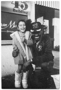 "[Photograph of Clarence ""Gatemouth"" Brown With a Young Girl]"