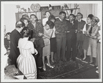Singing in large group with Lorraine Hansberry and Nina Simone