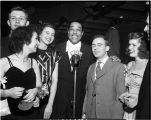 Jazz composer and bandleader Duke Ellington appears at WGY 25th anniversary celebration at Union College Memorial Field House. Next to Ellington is WGY announcer Howard Reig.