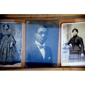 Three portraits of African-American youngsters.
