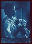 [Half-length portrait of African American woman, facing right, holding baby]
