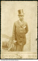 Portrait of an African-American man with a top hat and cane, Centerville, Indiana, ca. 1880