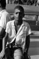 "Young boy seated on the trunk of a car during the ""March Against Fear"" through Mississippi, begun by James Meredith."