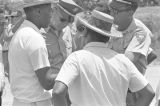 "Robert L. Green and Martin Luther King, Jr., speaking to Mississippi Highway Patrol officers during the ""March Against Fear"" through Mississippi, begun by James Meredith."