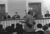 African American man addressing the mayor and trustees of the village of Freeport, New York.