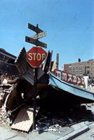 """Riots; Detroit; Race Riot.--Windows boarded up - 1 picture.--Stop sign in wreckage - 1 picture.--""""Peace on Earth"""" sign on building - 1 picture.--Used in """"A Time of Tragedy"""". A special section, Re: Riot. Published by Det. News Aug. 11, 1967.--Enc. 3 negs."""