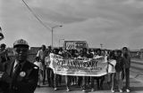 Marchers crossing the Edmund Pettus bridge in Selma, Alabama, during the 20th anniversary reenactment of the Selma to Montgomery March.