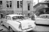Damaged cars and debris beside 16th Street Baptist Church in Birmingham, Alabama, after the building was bombed.