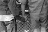 Two children holding hands.