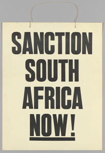 "Placard reading ""Sanction South Africa Now!"""
