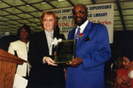 County Librarian and Isaac Hayes Hold Plaque