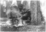 [Close-up of charred corpse of Jesse Washington, laying on ground, after lynching, Waco, Texas, May 15, 1916]