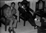 Richard Boone and Ralph Abernathy speaking while seated behind the podium during a meeting at Holt Street Baptist Church in Montgomery, Alabama.