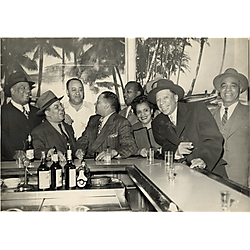 Eight men, including Gus Greenlee third from left, and a woman, at the bar of Crawford Grill no.1