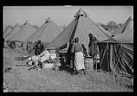 A Negro flood refugee family who, with their rescued household goods have moved into the camp at Forrest City, Arkansas