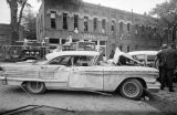 Thumbnail for Damaged car in the street after the bombing of 16th Street Baptist Church in Birmingham, Alabama.