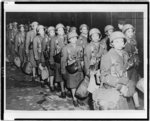 [First African American members of the Women's Army Corps assigned to overseas duty get off a train at night in England]