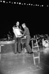 Tom Bradley presenting an award to Sammy Davis Jr., Los Angeles, 1980