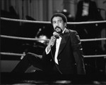 Richard Pryor performing while sitting in a boxing ring