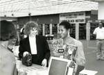 Marla Gibbs at the A C Bilbrew Circulation Desk