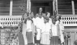 Group of students and teachers at Calhoun Colored School in Lowndes County, Alabama, standing on the front steps of a building.