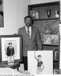 Abner Haynes posing with family portraits Dallas/Fort Worth Black Living Legends Dallas/Fort Worth Black Living Legends, 1991