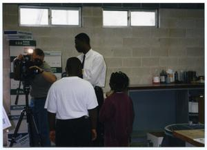 [Gates Elementary Students and Teacher Inside Urban Communications Inc. Facility] San Antonio Chapter of Links Records