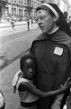 Nun on 129th Street in Harlem, conducting summer activities for the children there.