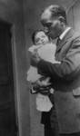 David holding infant son
