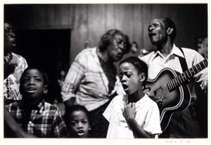 Doc and Lucy Barnes with kids singing