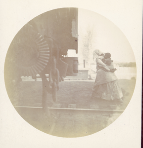 African-American Woman with Baby in Railroad Yard, ca.1893
