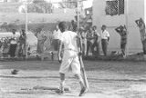 Young boy picking up bats during a baseball game, probably in Montgomery, Alabama.