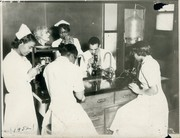 Miss D. Mosley and Mrs. G.E. Phelps teaching Medical Record Library students in the chemistry laboratory at Homer G. Phillips School of Nursing.