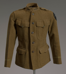 World War I enlisted soldier's tunic and cigarette holder