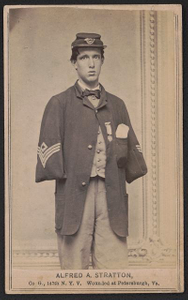 [Alfred A. Stratton of Co. G, 147th New York Infantry Regiment in uniform, with amputated arms]