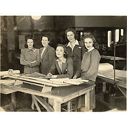5 women at drafting table