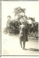Gentleman Walking Along the Sidewalk