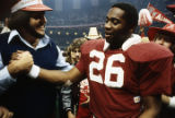 Alabama wide receiver James Mallard (#26) shaking hands with a fan after the 1980 Sugar Bowl game at the Superdome in New Orleans, Louisiana.