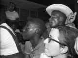 """People listening to a speaker at an evening gathering in Canton, Mississippi, during the """"March Against Fear"""" begun by James Meredith."""