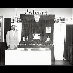 Man at Calvert whiskey promotional display