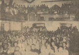 Newspaper photo of African Americans holding a civil rights meeting in a church.