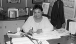 Lucille Boswell posing at her office desk, Los Angeles, 1986