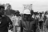 Dick Gregory and other marchers during the 20th anniversary commemoration of the Selma to Montgomery March, probably in rural Dallas or Lowndes County, Alabama.