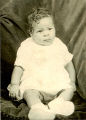 Unidentified baby in gown with shoes