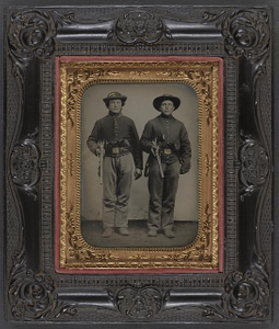 [Two unidentified soldiers in Union cavalry uniforms with Sharps rifles and Colt revolvers]